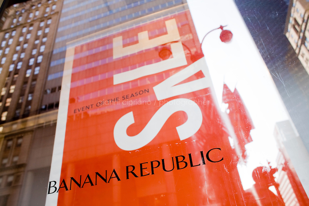 4 October, 2008. A sale sign in the window of the Banana Republic store of Grand Central Terminal. As the financial crisis spread last month, many retailers hit the panic button, offering more generous discounts than they did at the same time last year. But the promotions did little to convince cautious shoppers to open their wallets.<br /> <br /> ©2008 Gianni Cipriano for The Wall Street Journal<br /> cell. +1 646 465 2168 (USA)<br /> cell. +1 328 567 7923 (Italy)<br /> gianni@giannicipriano.com<br /> www.giannicipriano.com