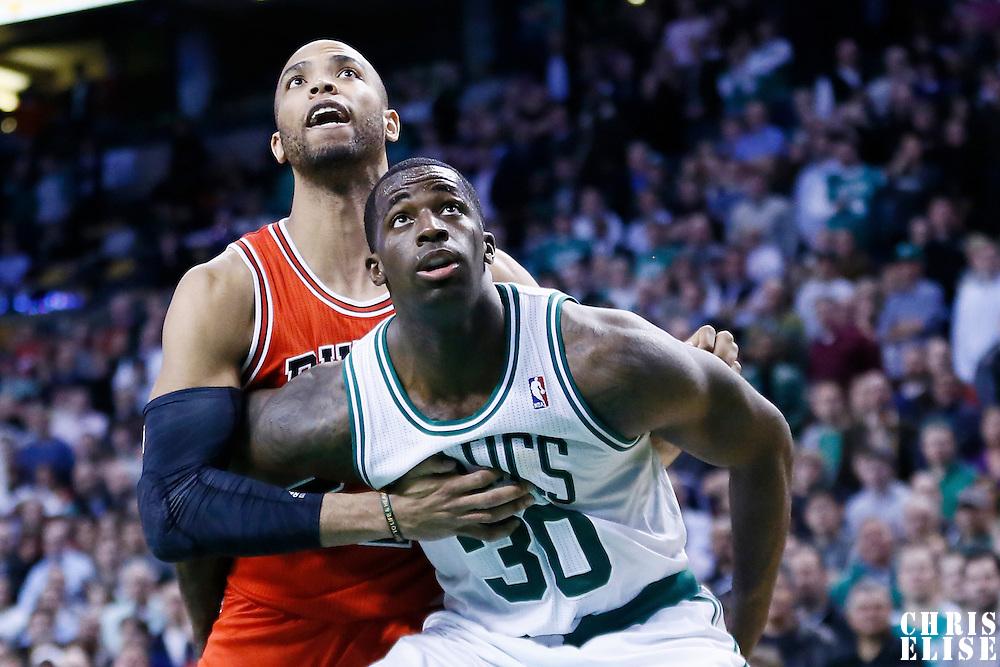 13 February 2013: Chicago Bulls power forward Taj Gibson (22) vies for the rebound with Boston Celtics power forward Brandon Bass (30) during the Boston Celtics 71-69 victory over the Chicago Bulls at the TD Garden, Boston, Massachusetts, USA.