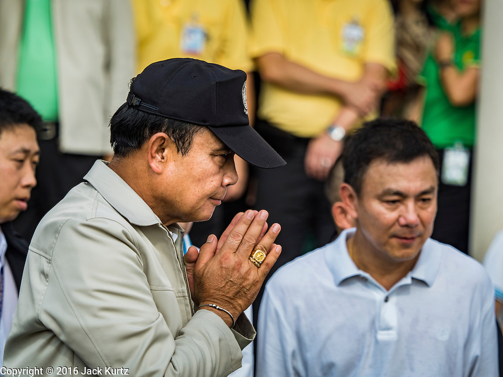 """09 JANUARY 2016 - BANGKOK, THAILAND: PRAYUTH CHAN-O-CHA, the Prime Minister of Thailand, """"wais"""" (a wai is a traditional Thai greeting) the crowd at Government House during Children's Day festivities at Government House. National Children's Day falls on the second Saturday of the year. Thai government agencies sponsor child friendly events and the military usually opens army bases to children, who come to play on tanks and artillery pieces. This year Thai Prime Minister General Prayuth Chan-ocha, hosted several events at Government House, the Prime Minister's office.       PHOTO BY JACK KURTZ"""