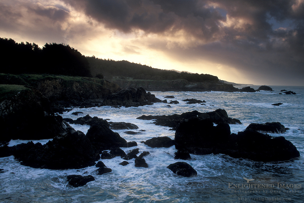 Storm clouds at sunrise over coastal cliffs and bluffs, Stillwater Cove Regional Park, Sonoma County Coast, California