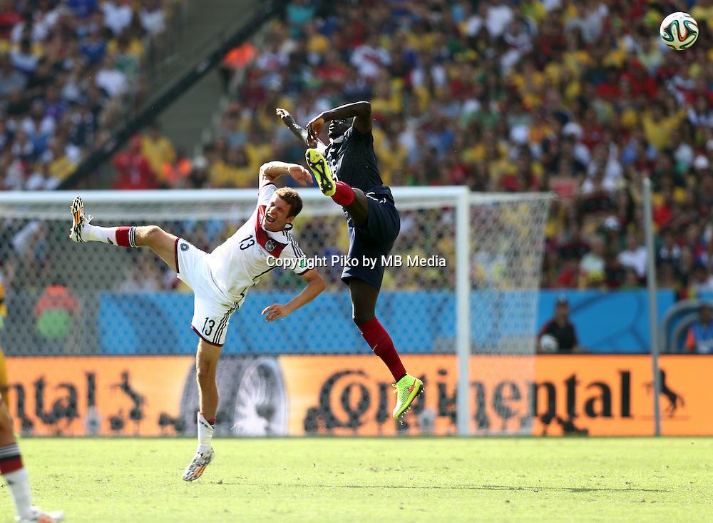 Fifa Soccer World Cup - Brazil 2014 - <br /> FRANCE (FRA) Vs. GERMANY (GER) - Quarter-finals - Estadio do Maracana Rio De Janeiro -- Brazil (BRA) - 04 July 2014 <br /> Here German player Thomas MUELLER (L) and French player Mamadou SAKHO (R)<br /> &copy; PikoPress
