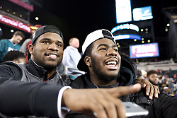 Panthers alumnus and South Carolina University running back Dave Williams and Panthers senior Naseir Upshur, committed to play for Florida State University, watch the Eagles game.<br /> <br /> Football players of PIAA AAA State champions Imhotep Panthers and Pop Warner Midget Div. I National Champions NW Raiders got invited to see the December 26, 2015 NFC East Division game between Washington Redskins and Philadelphia Eagles at Lincoln Financial. 9photo by Bastiaan Slabbers)