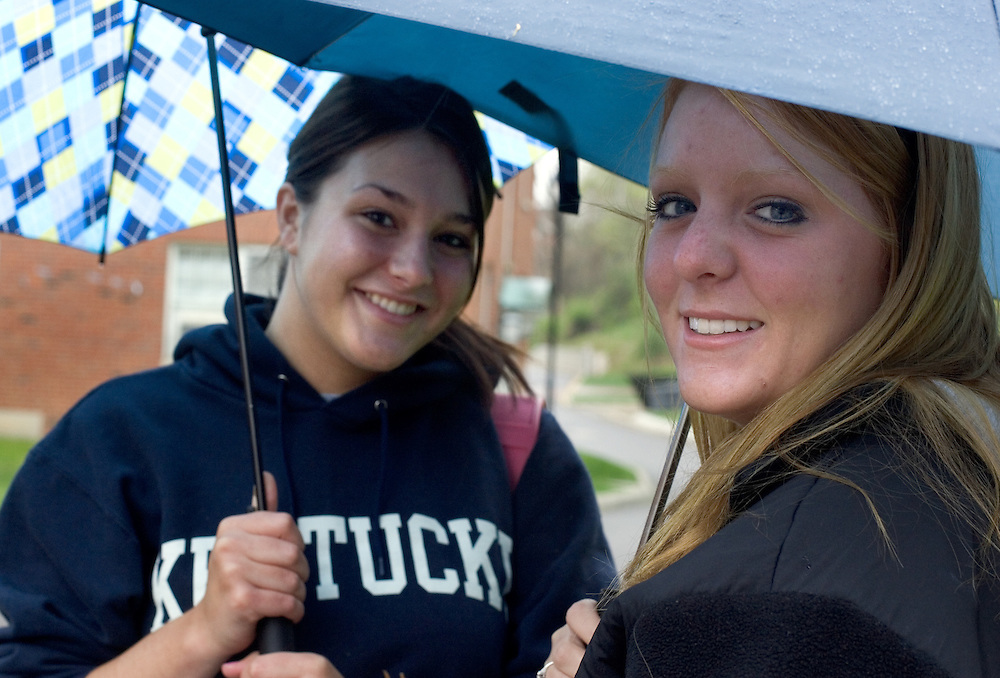 Annie McCune (left) and Jackie Wentz pause for a photo while walking through the rain on O.U.'s campus Wednesday, 4/11/07.