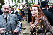 MARK POWELL; EILEEN DAVY, Sebastian Horsley funeral. St. James's church. St. James. London afterwards in the church garden. July 1 2010. -DO NOT ARCHIVE-© Copyright Photograph by Dafydd Jones. 248 Clapham Rd. London SW9 0PZ. Tel 0207 820 0771. www.dafjones.com.