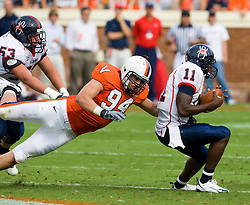 Virginia defensive end Matt Conrath (94) dives to sack Richmond quarterback Eric Ward (11).  The Virginia Cavaliers defeated the #3 ranked (NCAA Division 1 Football Championship Subdivision) Richmond Spiders 16-0 in a NCAA football game held at Scott Stadium on the Grounds of the University of Virginia in Charlottesville, VA on September 6, 2008.