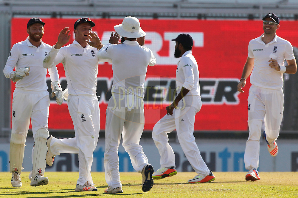 Jos Buttler of England celebrates the wicket of Karun Nair of India during day 2 of the third test match between India and England held at the Punjab Cricket Association IS Bindra Stadium, Mohali on the 27th November 2016.<br /> <br /> Photo by: Deepak Malik/ BCCI/ SPORTZPICS
