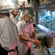 Chef Danny Bowien, right, works in the kitchen of his restaurant, Mission Chinese, at its New York City location on the Lower East Side of Manhattan on Tuesday, July 31, 2012 in New York, NY..