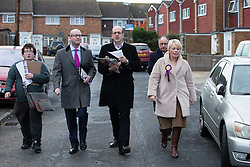© Licensed to London News Pictures . 17/11/2014 . Kent , UK . UKIP candidate Mark Reckless (3rd from left) with UKIP deputy leader Paul Nuttall (2nd from left) canvassing votes in Strood in the Rochester and Strood by-election . They meet Fatima Macaulay (right) who says she's voting UKIP . Photo credit : Joel Goodman/LNP