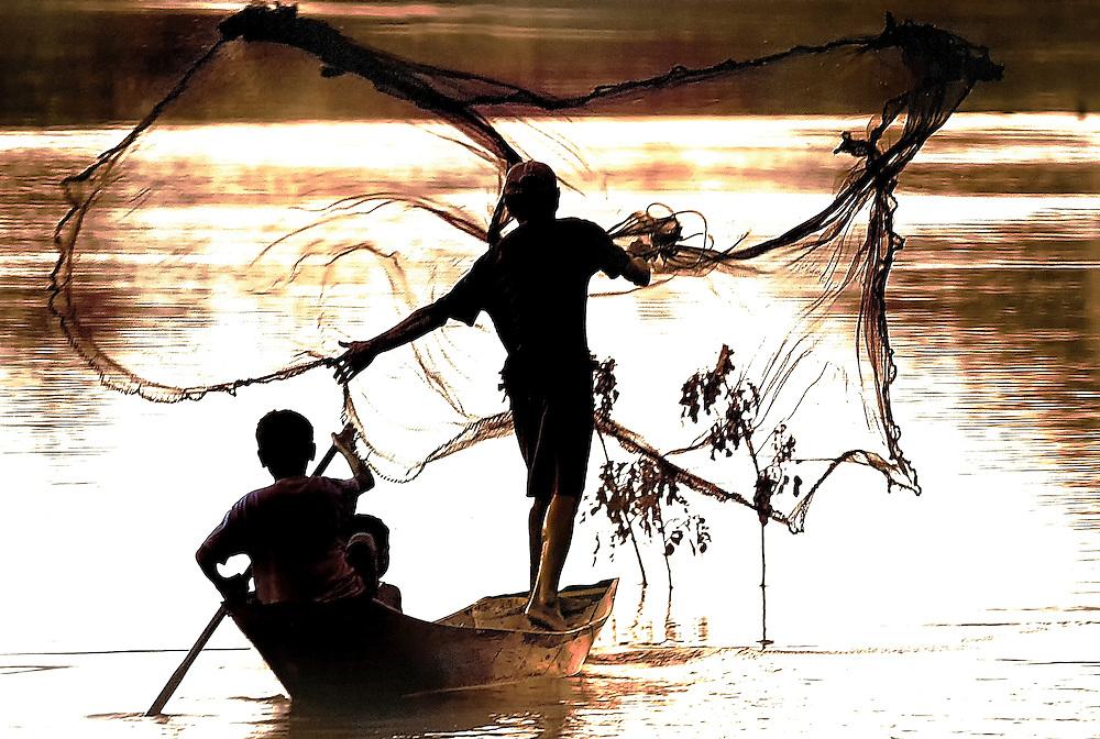 Fishermen at sunset in Savannakhet, Laos.