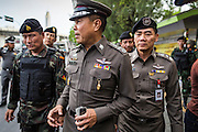 29 MAY 2014 - BANGKOK, THAILAND: General SOMYOT POOMPANMOUNG, deputy national police chief of Thailand, inspects Thai soldiers on duty around Victory Monument. More than 1,300 soldiers and police were used to prevent an outbreak of protests at the Monument.  After a series of protests around Victory Monument earlier in the week, the Thai army Thursday shut down vehicle access to the area, one of the main intersections in Bangkok, and kept people out of the area. Thousands of soldiers surrounded the Monument and effectively locked the area down. There were no protests at Victory Monument for the first time in the week since the coup deposed the elected civilian government.   PHOTO BY JACK KURTZ