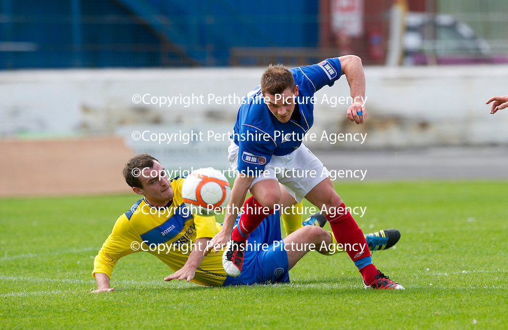 Cowdenbeath v St Johnstone....21.07.12  pre-season friendly<br /> David Robertson tackles Mark Ramsay<br /> <br /> Picture by Graeme Hart.<br /> Copyright Perthshire Picture Agency<br /> Tel: 01738 623350  Mobile: 07990 594431