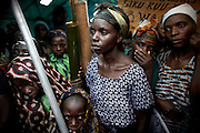 Displaced women calling for an end to sexual violence gather to celebrate Women's Day, in Kichanga, DRC, on Saturday, March. 8, 2008..Sexual violence is systematic in DRC with the brutality of attacks often leaving the victims with severe damage to reproductive organs, resulting in multiple fistulas and incontinence. According to the UN Population Fund an average of 1,100 rape cases are reported each month..