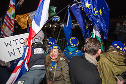 London, UK. 13th March, 2019. Anti-Brexit activists from SODEM (Stand of Defiance European Movement) celebrate outside the Houses of Parliament as they learn that MPs had just voted to reject a 'No Deal' Brexit.