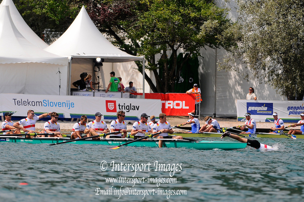 Bled, SLOVENIA. GER M8+, Gold Medal, Cox Martin SAUER takes a celebratory dip in Lake Bled having coxed his crew to Gold in M8+,  2011 FISA World Rowing Championships, Lake Bled. Thursday  01/09/2011   [Mandatory Credit; Intersport Images]