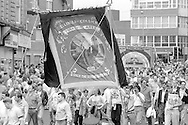 A black draped Kellingley Colliery banner. 1988 Yorkshire Miner's Gala. Wakefield.