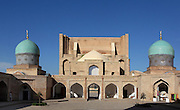 """Low angle view of central patio of Barak-Khan Madrassah, 16th-17th century, Tashkent, Uzbekistan, seen on July 4, 2010, in the late afternoon summer light. Tashkent, 2000 year old capital city of Uzbekistan, a Silk Road city whose name means """"Stone Fortress"""", is now very modern due to a disastrous earthquake in 1966, after which it was greatly rebuilt. However, some of the old buildings still stand in the glittering modern city. Picture by Manuel Cohen."""