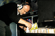 John Peel (RIP), DJ, looking through his records, Paris Techno Parade, 2000's