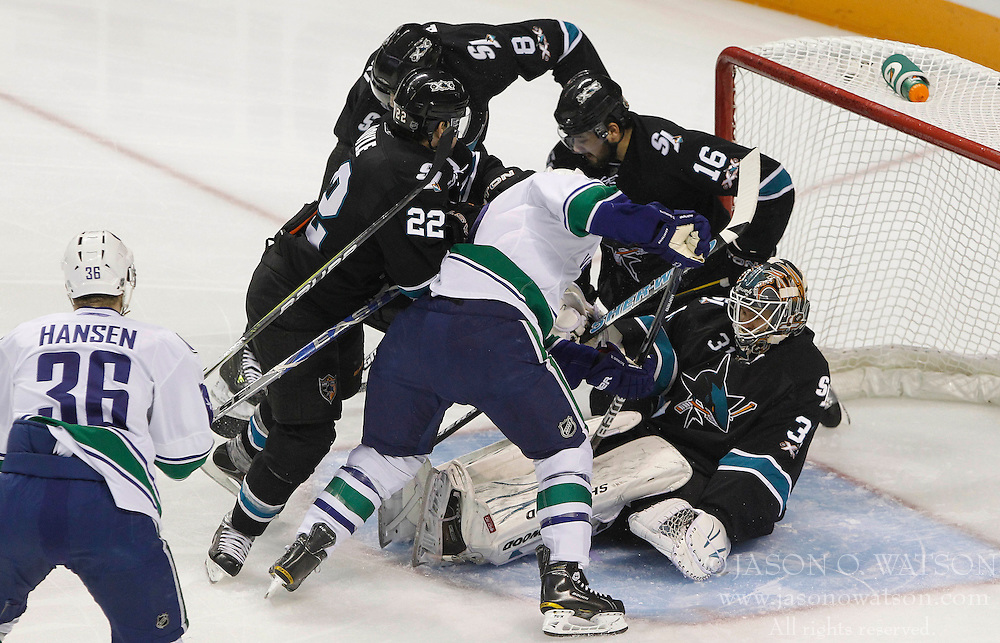 May 22, 2011; San Jose, CA, USA; San Jose Sharks goalie Antti Niemi (bottom) makes a save against the Vancouver Canucks during the first period of game four of the western conference finals of the 2011 Stanley Cup playoffs at HP Pavilion. Mandatory Credit: Jason O. Watson / US PRESSWIRE