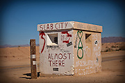 Abandoned guard post marking the entry to eccentric Slab City in the desert outside Niland, CA.