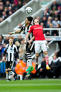 Newcastle United forward Ayoze Perez (#17) and Barnsley midfielder Josh Scowen (#6) contest the ball in the air during the EFL Sky Bet Championship match between Newcastle United and Barnsley at St. James's Park, Newcastle, England on 7 May 2017. Photo by Craig Doyle.