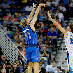 Apr 14, 2013; New Orleans, LA, USA; Dallas Mavericks power forward Dirk Nowitzki (41) shoots over New Orleans Hornets center Robin Lopez (15) during the first half of a game at the New Orleans Arena. Mandatory Credit: Derick E. Hingle-USA TODAY Sports