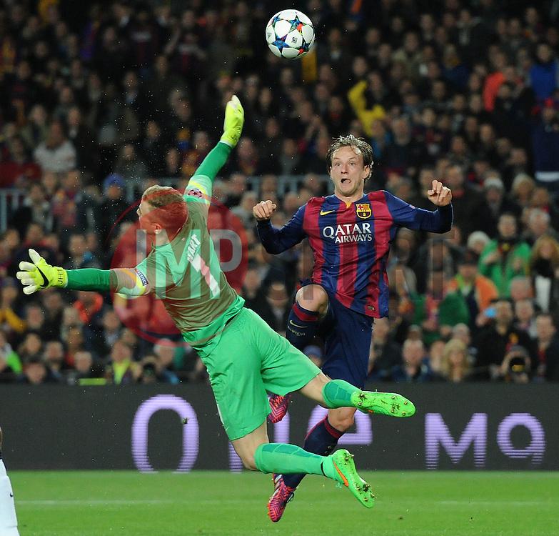 Barcelona's Ivan Rakitic scores a goal by chipping Manchester City's Joe Hart - Photo mandatory by-line: Dougie Allward/JMP - Mobile: 07966 386802 - 18/03/2015 - SPORT - Football - Barcelona - Nou Camp - Barcelona v Manchester City - UEFA Champions League - Round 16 - Second Leg