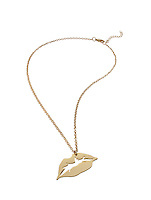 Gold lip necklace on white background