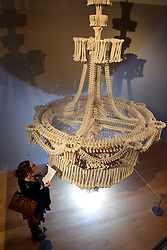 """© Licensed to London News Pictures. 14/11/2012. London, UK """"In the Eyes of Others"""" a huge chandelier made of 3000 plaster cast bones by British artist Jodie Carey. Press preview of """"Death: A Self -Portrait. The Richard harris Collection"""" at The Welcome Collection today 14th November 2012. The exhibition showcases 300 works from a unique collection devote to the iconography of death and mankind's attitude towards it. Photo credit : Stephen Simpson/LNP"""