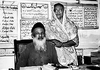 Pakistan, Karachi, 2004. At home in their original Mithadar office in the Saddar Bazaar, a portrait of a remarkable humanitarian team.