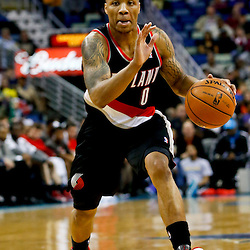 Feb 13, 2013; New Orleans, LA, USA; Portland Trail Blazers point guard Damian Lillard (0) drives with the ball against the New Orleans Hornets during the second half of a game at the New Orleans Arena. The Hornets defeated the Trail Blazer 99-63. Mandatory Credit: Derick E. Hingle-USA TODAY Sports