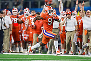 Clemson Tigers running back Travis Etienne (9) runs for a 62-yard-touchdown late in the third quarter in the NCAA Cotton Bowl semi-final playoff football game against the Notre Dame Fighting Irish, Saturday, Dec. 29, 2018, in Arlington, Texas. Clemson defeated Notre Dame 30-3 to advance to the College Football Playoff national Championship. (Mario Terana/Image of Sport)