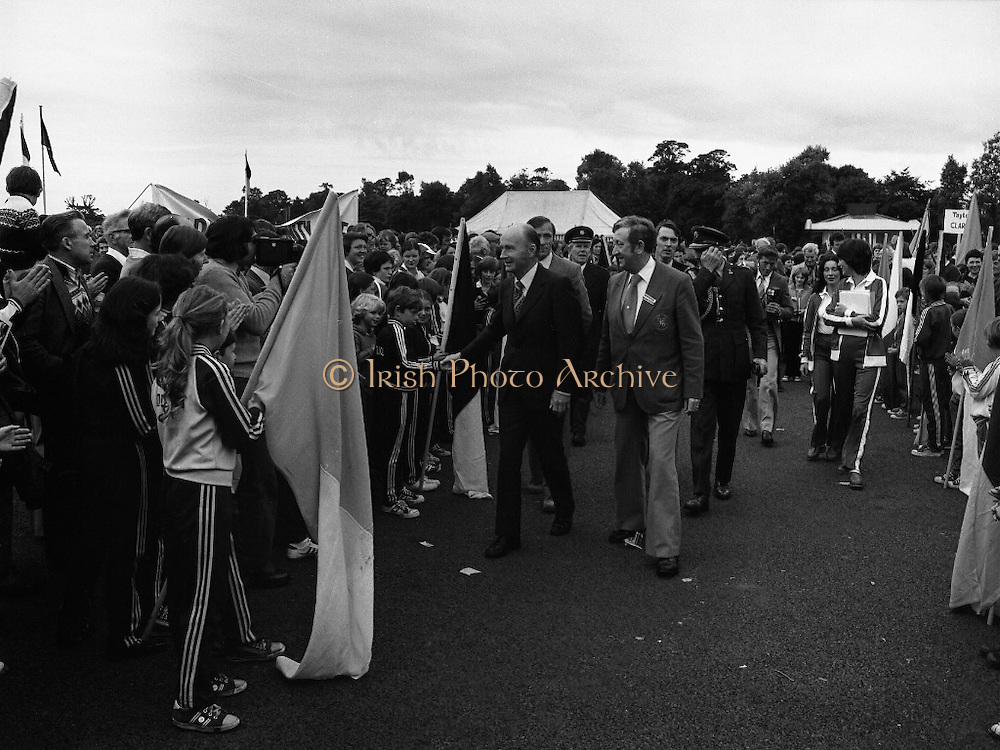 President Hillery at The Community Games..1979..15.09.1979..09.15.1979..15th September 1979..President Patrick Hillery attended the opening of The National Community Games finals at Mosney, Co Meath today. The finals were held in the grounds of The Butlins Holiday Centre and were sponsored by Tayto Irl Ltd,Greencastle Road,Coolock,Dublin..Picture shows President Hillery meeting some of the contestants and their families on his arrival at Mosney.