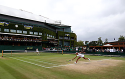 General view of the wear and tear to the grass on the baseline of court four as Whitney Osuigwe stretches for the ball on day eight of the Wimbledon Championships at The All England Lawn Tennis and Croquet Club, Wimbledon.