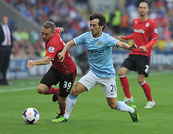 Cardiff City's Craig Bellamy battles for the ball with Manchester City's David Silva  - Photo mandatory by-line: Alex James/JMP - Tel: Mobile: 07966 386802 25/08/2013 - SPORT - FOOTBALL - Cardiff City Stadium - Cardiff -  Cardiff City V Manchester City - Barclays Premier League