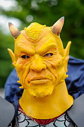 © Licensed to London News Pictures. 28/05/2017. London, UK. A man dressed as Etrigan from DC Comics at MCM Comic Con taking place at Excel in East London.  The three day event celebrates popular comic books, anime, games, television and movies.  Many attendees take the opportunity to dress as their favourite characters.    Photo credit : Stephen Chung/LNP