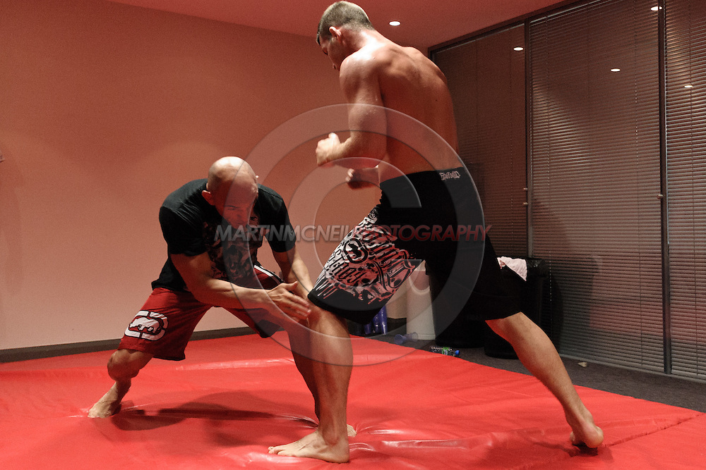 MANCHESTER, ENGLAND, NOVEMBER 11, 2009: Zach Light (left) and Michael Bisping work on grappling drills at the open work-outs for UFC 105 at the Crowne Plaza Hotel in Manchester, England on November 11, 2009.