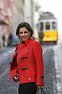 Katia Guerreiro walking in Calcada de Sao Vicente in Alfama old neighborhood, with a typical Lisbon tram on the background. Fado singer Katia Guerreiro is one of the young singers generation  that are bringing a new strenght to this traditional kind of portuguese music.