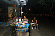 Isabel sells sweets in Rio de Janeiro to top up her income as a maid. Here she sits with her son, Paulo.<br />