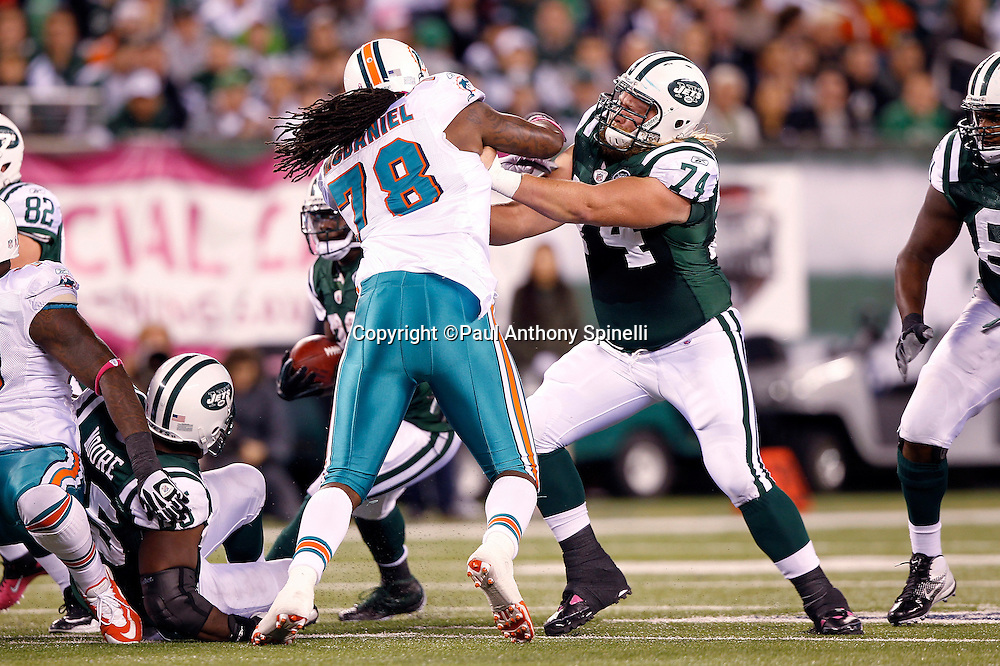 Miami Dolphins defensive tackle Tony McDaniel (78) blocks New York Jets center Nick Mangold (74) during the NFL week 6 football game against the New York Jets on Monday, October 17, 2011 in East Rutherford, New Jersey. The Jets won the game 24-6. ©Paul Anthony Spinelli