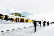 People walk towards the Oslo Opera House at dusk in Oslo, Norway. © Brett Wilhelm
