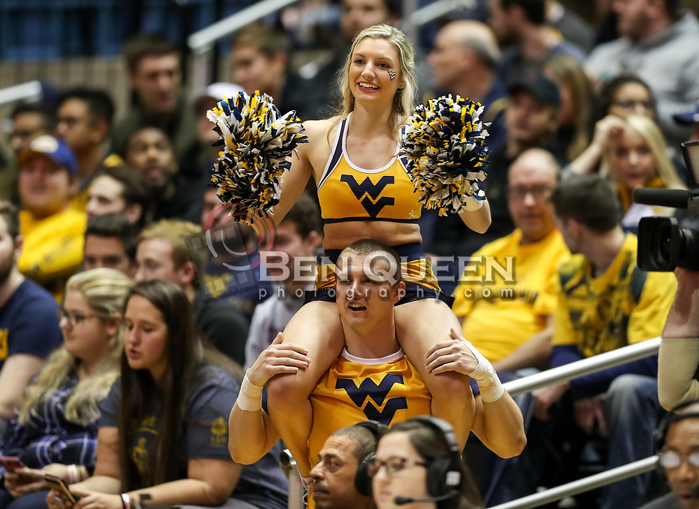 Dec 20, 2017; Morgantown, WV, USA; West Virginia Mountaineers cheerleaders perform during the first quarter against the Coppin State Eagles at WVU Coliseum. Mandatory Credit: Ben Queen-USA TODAY Sports