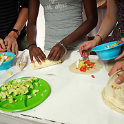 Students prepare tortillas and burritos in Agua Perieta, Mexico