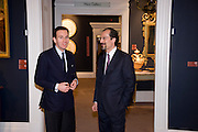 MARIO TAVELLA; FILIPPO LOTTI, Preview party for the Versace Sale.  The contents of fashion designer Gianni Versace's villa on Lake Como. Sothebys. Old Bond St. London. 16 March 2009.  *** Local Caption *** -DO NOT ARCHIVE -Copyright Photograph by Dafydd Jones. 248 Clapham Rd. London SW9 0PZ. Tel 0207 820 0771. www.dafjones.com<br /> MARIO TAVELLA; FILIPPO LOTTI, Preview party for the Versace Sale.  The contents of fashion designer Gianni Versace's villa on Lake Como. Sothebys. Old Bond St. London. 16 March 2009.