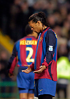 Photo. Jed Wee.<br /> Glasgow Celtic v Barcelona, UEFA Cup, Celtic Park, Glasgow. 11/03/2004.<br /> Barcelona's Brazilian star Ronaldinho remains motionless in earnest prayer for the victims of the terrorist attack in Spain after the minute's silence.