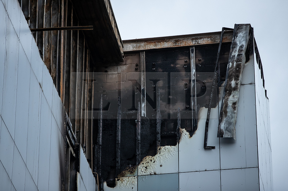 "© Licensed to London News Pictures. 16/11/2019. Bolton, UK. Damage to cladding at the site of the blaze where a fire broke out overnight (15th/16th November 2019) at a block of flats known as "" The Cube "" , in Bolton Town Centre . At least two people are known to have been treated by paramedics at the scene of the six-story block , which is occupied by students of the University of Bolton and questions are now being raised about the safety of the high pressure laminate cladding used in the building's construction . Photo credit: Joel Goodman/LNP"