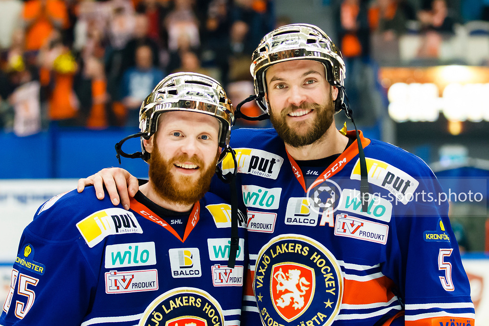 Malte Strömwall and Noah Welch of Växjö Lakers with their golden helmets, after the Swedish ice hockey Final between Växjö Lakers and Skellefteå AIK at Vida Arena on April 23, 2015 in Växjö, Sweden.