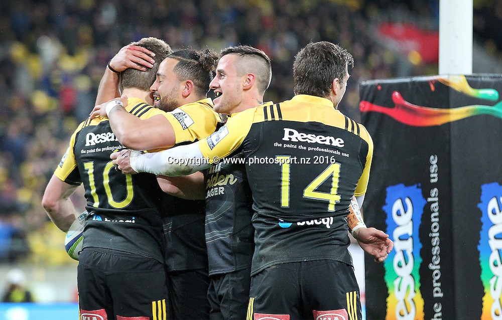 Hurricanes' Beauden Barrett celebrates his first half try with Matt Proctor, TJ Perenara & Cory Jane during the Investec Super Rugby Semi-Final match, Hurricanes v Chiefs at Westpac Stadium, Wellington, New Zealand. 30th July 2016. © Copyright Photo: Grant Down / www.photosport.nz