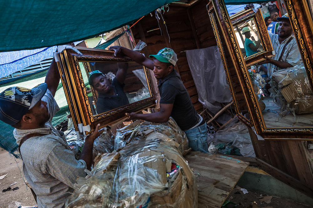 DAJABÓN, DOMINICAN REPUBLIC - JUNE 26, 2015:  Mirrors for sale at the binational frontier market zone in the Dominican Republic.  Twice a week, the border is opened up so that Haitians can pass freely to go to the market without registering with border officials. PHOTO: Meridith Kohut for The New York Times