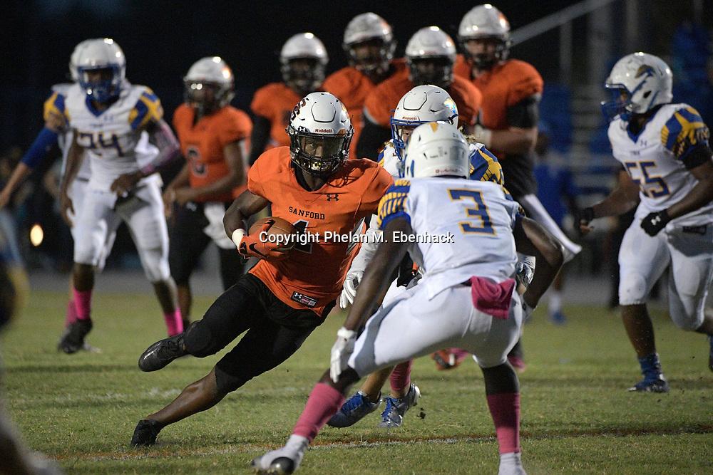 Seminole's Juri Sabb (1) runs for yardage in front of Lyman's J.T. Tillman (3) during the first half of a high school football game Friday, Oct. 6, 2017, in Sanford, Fla. (Photo by Phelan M. Ebenhack)