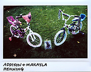 The bicycles of 5-year-old twins Addison and Makayla Henning are seen on their front lawn in the 400 block of North Reed Street in suburban Joliet, Illinois, August 31, 2017. The girls died from multiple gun shots to the head and their mother Celisa Henning, 41-year-old, died from a single gunshot on August 28, 2017 in what police are investigating as a murder-suicide.